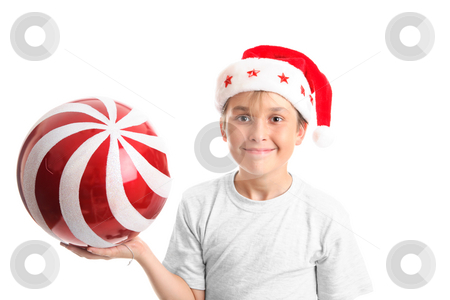 Child holding a large bauble stock photo, Boy holding a large red Christmas bauble with glitter swirls by Leah-Anne Thompson