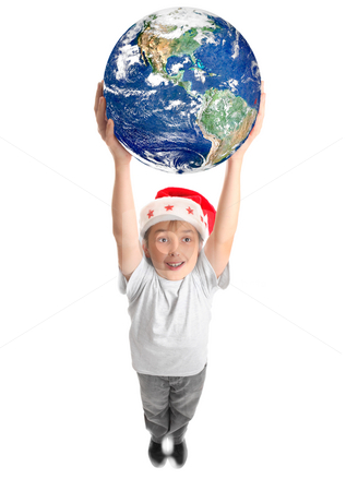 Celebrate Christmas around the World stock photo, A smiling joyous boy holding our planet Earth with two hands above his head.  Concept by Leah-Anne Thompson