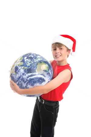 Embracing the joy of Christmas around the world stock photo, Boy holding globe.  Embracing the love and joy of Christmas around the world. by Leah-Anne Thompson