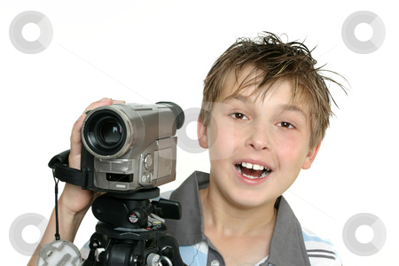 Shooting a video stock photo, A child using a video camera and tripod by Leah-Anne Thompson