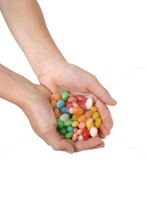 Handful of jelly beans stock photo, A child holds a handful of coloured lollies / candy. by Leah-Anne Thompson