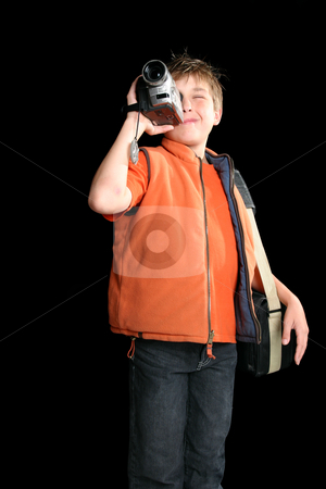 Child filming with digital video camera stock photo, Video production is a creative way to enhance a child's learning and education by Leah-Anne Thompson