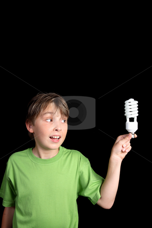 Child holds a compact fluorescent globe stock photo, A boy holds an energy efficient compact fluorescent light bulb with space for your text or message. vertical. by Leah-Anne Thompson