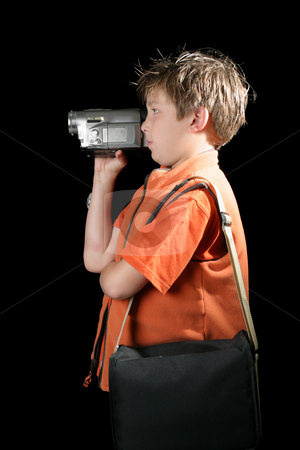 Creating home movies stock photo, A child using a digital video camera to record a home movie. by Leah-Anne Thompson