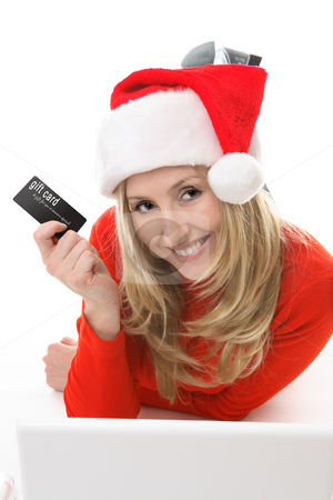 Santa Girl shopping with a card stock photo, Save your legs.  Blonde santa girl with a gift card or credit or debit card conveniently shopping online.  Add your own card, brochure, etc in her hand  or replace the text with your own design. by Leah-Anne Thompson