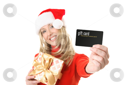 Woman holding gift card, credit card etc stock photo, A woman holding a gift and outstretched arm showing a gift card, credit card or other card or object.  Focus is the hand and card.  Change the card or text to suit your needs. by Leah-Anne Thompson