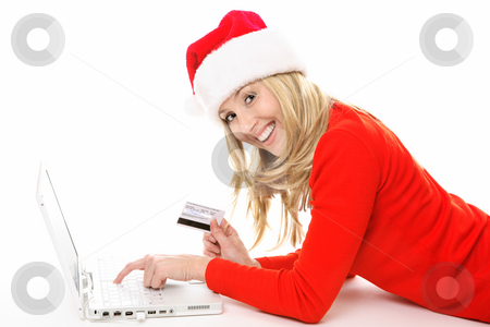 Shopping and banking online easy and secure stock photo, Shopping online is easy, convenient and secure.  Smiling female using a laptop and holding a credit card or other card to buy Christmas gifts, pay bills or  banking.  All data on back of  card has been replaced with made up info.   This is not a real card but is made to look like one.. by Leah-Anne Thompson