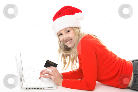 Christmas Shopping club stock photo, Girl using a card to shop safely  online.  She has a card in one hand and is looking up and smiling.  Change the text or add in your own card or credit card. by Leah-Anne Thompson