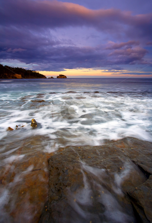 Flooded at Sunset stock photo, Rising Tides flood the Tesselated Pavement on the Tasman Peninsula at Sunset by Mike Dawson