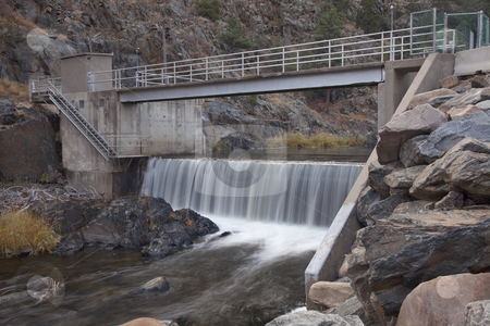 Diversion dam on a mountain river flowing in deep, dark canyon stock photo, Deep and dark canyon of Big Thompson River with a small dam diverting water for farmland irrigation, Rocky Mountains, Colorado. by Marek Uliasz