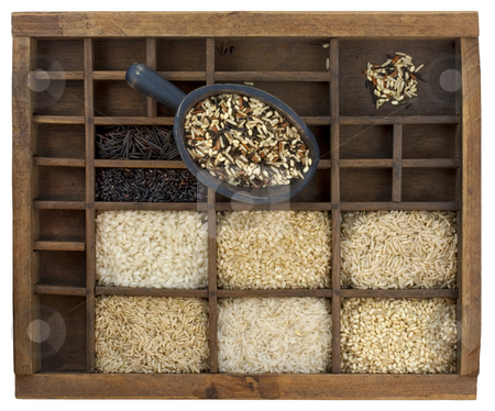 Variety of rice grains in vintage wooden drawer with scoop stock photo, Variety of rice grains (white, brown, black, forbidden, wild, basmati, arborio, short, long grain) in vintage wooden typesetter case with rustic scoop isolated with clipping path by Marek Uliasz