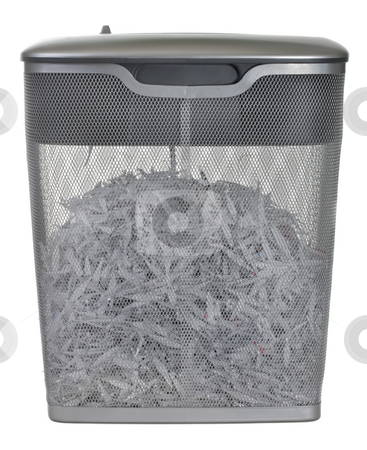 Light duty paper shredder stock photo, Light duty paper shredder with metal wire basket filled with document shreddings, isolated on white by Marek Uliasz