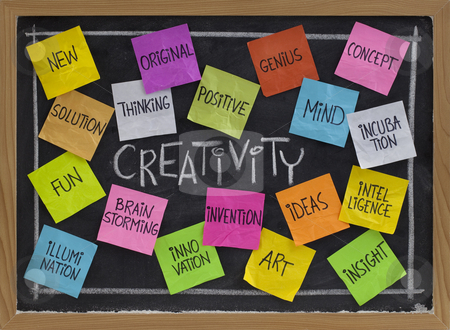 Creativity word cloud on blackboard stock photo, Creativity concept - related cloud of words, color sticky notes and white chalk handwriting on blackboard by Marek Uliasz