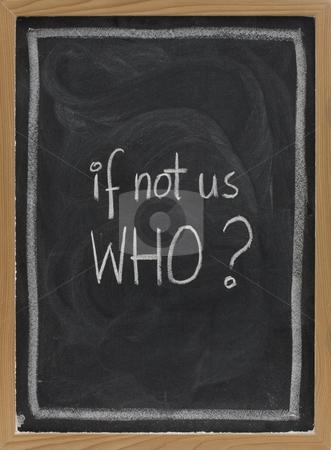If not us, who - question on blackboard stock photo, If not us, who - question handwritten with white chalk on blackboard, eraser smudge patterns by Marek Uliasz