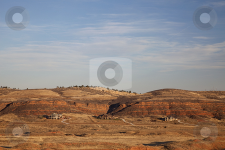 Mountain Colorado luxury housing  stock photo, Colorado luxury houses at foothills of Rocky Mountains near Loveland, red sandstone cliffs, fall scenery at sunset with dry vegetation by Marek Uliasz