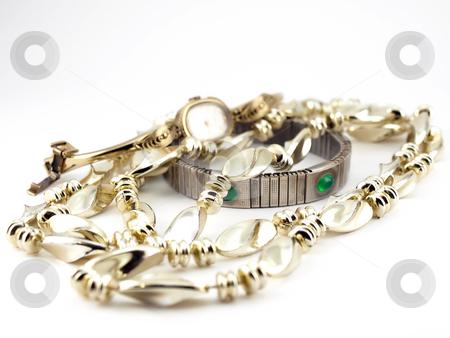 Beads, bracelet and watch stock photo,  by Sergei Devyatkin
