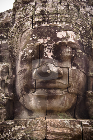 Ancient statue of Buddha in Angkor-wat stock photo, Ancient limestone bass-relief of Buddha in Angkor-wat, Cambodia by Pavel Filippov