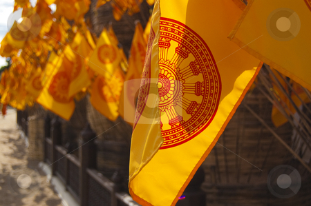 Yellow flags near Asian Wat stock photo, Bunch of yellow flags located near Thai Wat (temple) by Pavel Filippov