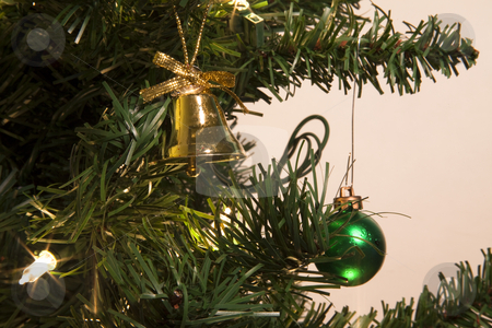 Christmas tree with ornaments and bell. stock photo, A christmas tree with ornaments and a bell. by Jared Davidson