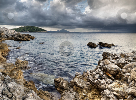 On  the shore stock photo, Rocky shore on the Adriatic sea with the rainy clouds , HDR image by Vladimir Koletic