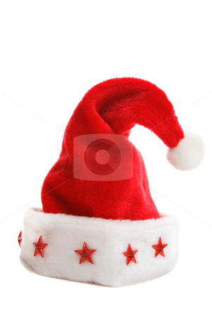 Christmas Santa Hat stock photo, A Santa hat with red stars decorating the rim sitting on a  plain white backdrop by Leah-Anne Thompson