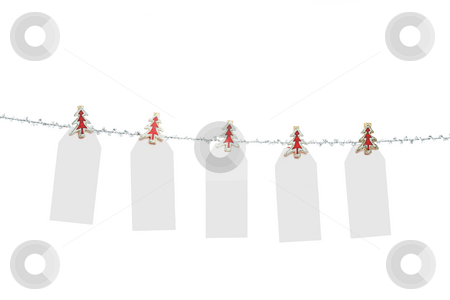 Blank Christmas Tags stock photo, Five blank Christmas tags pegged to a silver tinsel string  line - ready for your own text or message. by Leah-Anne Thompson