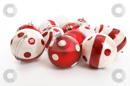 Christmas Decorations stock photo, Christmas decorations sitting on a white background.  Focus to foreground balls. by Leah-Anne Thompson