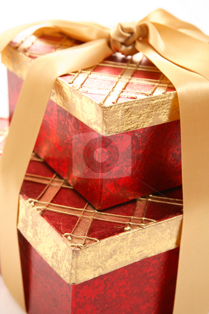 Red and gold gift closeup stock photo, Red and gold gifts closeup with shallow dof. by Leah-Anne Thompson