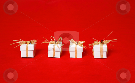 Little gifts stock photo, White gift boxes tied with raffia by Leah-Anne Thompson