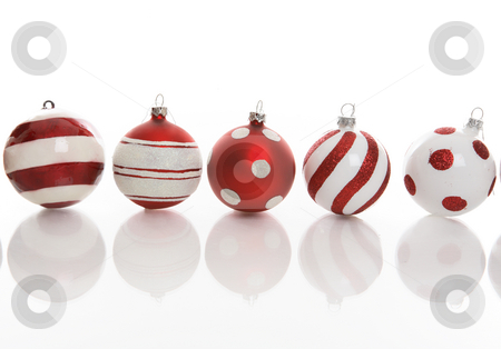 Five Festive Christmas Baubles stock photo, Red and white Christmas baubles with various designs on a white background. by Leah-Anne Thompson