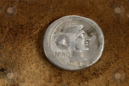 Roman Silver Denarius Coin 89 BC stock photo, M. Porcius Cato  Rome.   Front side of Roman Republic (200-30bc) silver coin AR denarius (89bc) depicting female draped hair taken in chignon.  Behind the nape of the neck, ROMA, Under the neck, M.Cato.  From the time of Caesar,   Issuance of coinage was administered by annuallly elected magistrates (moneyers).  A period of internal conflicts.  The era of Julius Caesar, Marc Antony, Brutus. by Leah-Anne Thompson