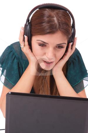 Listening to Music stock photo, Beautiful young woman  with headphones and laptop  Listening to Music by Remy Musser