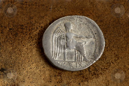 Roman Silver Coin 89 BC stock photo, Reverse side of Roman Republic (200-30bc) silver coin AR denarius (89bc) depicting Victory Seated. The Victoire sitting. With the epigraph, VICTRIX. by Leah-Anne Thompson