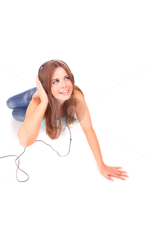 Listening to Music stock photo, Funny Beautiful young woman  Listening to Music by Remy Musser