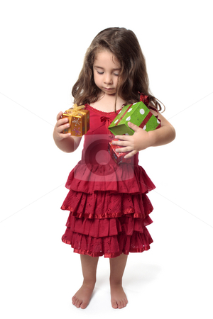 Little girl with armful of presents stock photo, Young girl in pretty red dress holding an armful of red, green and gold gifts. by Leah-Anne Thompson