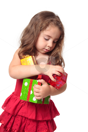 Girl holding an armful of Christmas presents stock photo, Little girl holding some Christmas presents in her arms. by Leah-Anne Thompson