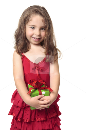 Pretty girl holding a present stock photo, Little girl in a red dress holds a green and red present and smiles sweetly. by Leah-Anne Thompson