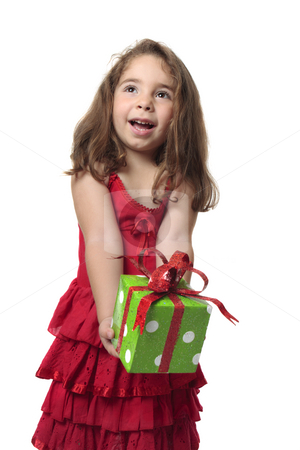 Girl holding gift stock photo, Young happy child holding a present with gleeful smile by Leah-Anne Thompson