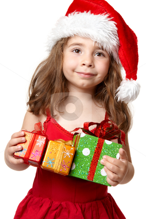 Little girl holding Christmas Presents stock photo, Young child in red dress and red santa hat holding Christmas presents by Leah-Anne Thompson
