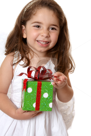 Angelic girl holding a gift stock photo, Pretty little girl holding a present and smiling. by Leah-Anne Thompson