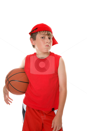 Basketball player stock photo, A hot and sweaty young player with attitude stands with a basketball. by Leah-Anne Thompson