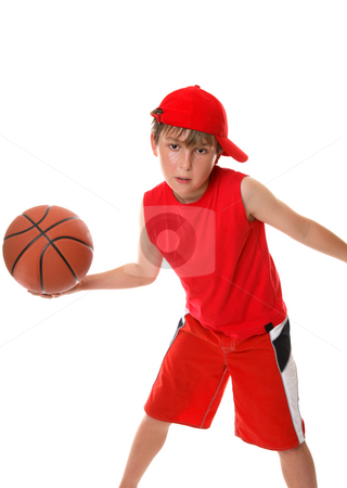 Playing  basketball stock photo, An active boy plays around with a basketball by Leah-Anne Thompson