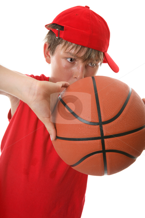 Boy playing with basketball stock photo, Closeup of a  young active boy playing with a basketball by Leah-Anne Thompson