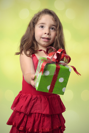 Pretty girl giving present stock photo, Pretty little girl with arms outstretched, giving at present. by Leah-Anne Thompson
