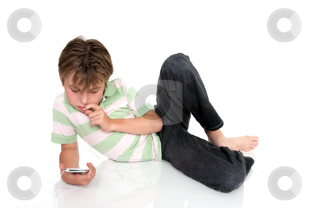 Child relaxing with an electronic gadget stock photo, Child relaxing with electronic music player. by Leah-Anne Thompson