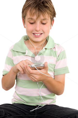 Child using a digital player stock photo, Child sitting down using a digital player.  He is wearing a striped polo shirt and jeans. by Leah-Anne Thompson
