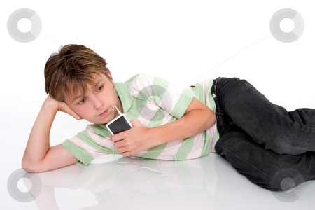 Child with a portable mp3 player stock photo, A child relaxes with a portable digital mp3 player by Leah-Anne Thompson