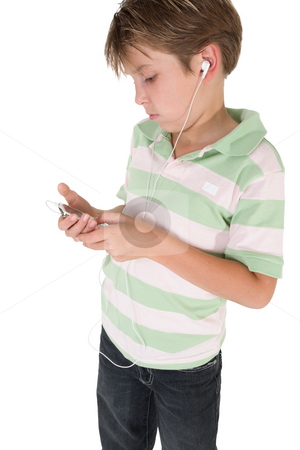 Child using an mp3 music player stock photo, A casual dressed child using an mp3 music player. by Leah-Anne Thompson