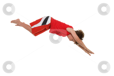 Dive right in stock photo, A boy diving  in action.   Some motion present in the lower shorts. by Leah-Anne Thompson