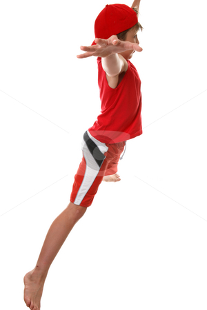 Fitness star jumps stock photo, An active fit  boy doing star jumps - side profile. by Leah-Anne Thompson